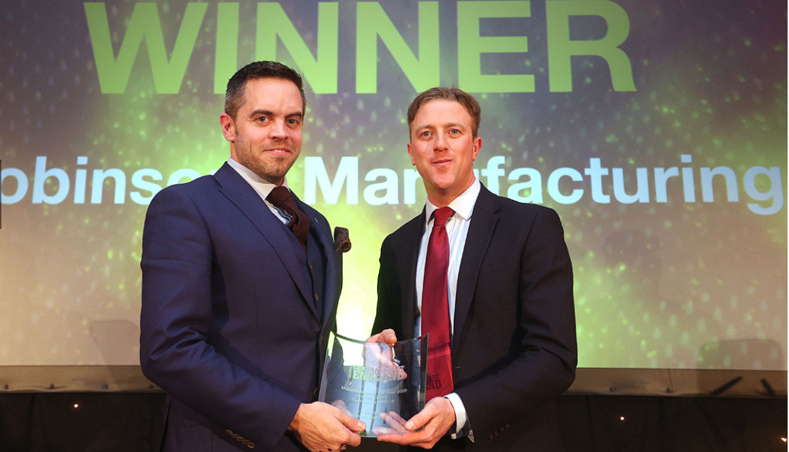 Mat Harbour receiving Insider's manufacturing award on RML's behalf